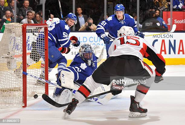 Zack Smith of the Ottawa Senators scores the third period game winning goal on Jonathan Bernier of the Toronto Maple Leafs during NHL game action...