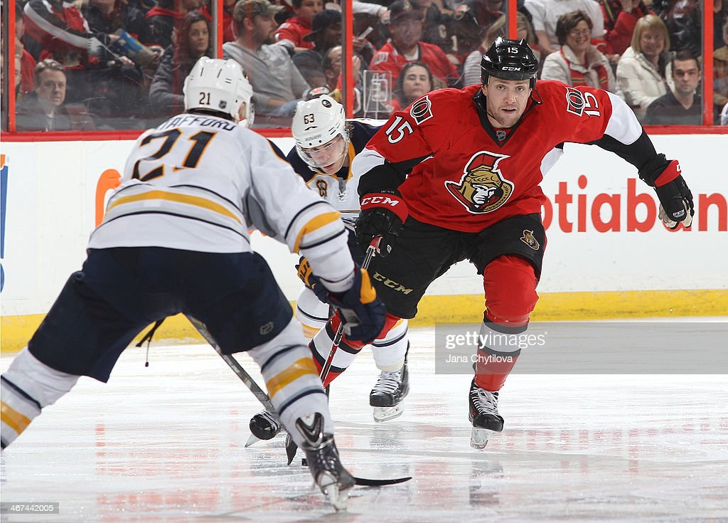 Zack Smith #15 of the Ottawa Senators skates with the puck against <a gi-track='captionPersonalityLinkClicked' href=/galleries/search?phrase=Drew+Stafford&family=editorial&specificpeople=220617 ng-click='$event.stopPropagation()'>Drew Stafford</a> #21 of the Buffalo Sabres as Tyler Ennis #63 of the Buffalo Sabres chases him during an NHL game at Canadian Tire Centre on February 6, 2014 in Ottawa, Ontario, Canada.