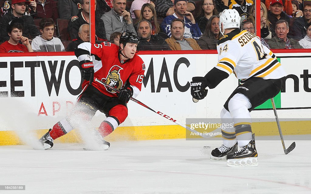 Zack Smith #15 of the Ottawa Senators stickhandles the puck against <a gi-track='captionPersonalityLinkClicked' href=/galleries/search?phrase=Dennis+Seidenberg&family=editorial&specificpeople=204616 ng-click='$event.stopPropagation()'>Dennis Seidenberg</a> #44 of the Boston Bruins on March 21, 2013 at Scotiabank Place in Ottawa, Ontario, Canada.