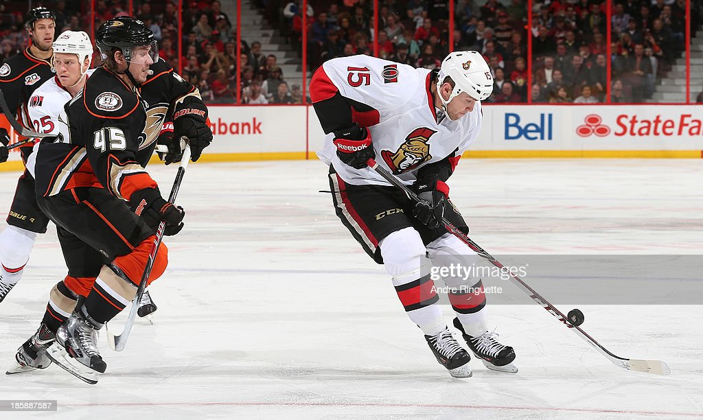 Zack Smith #15 of the Ottawa Senators stickhandles the puck against <a gi-track='captionPersonalityLinkClicked' href=/galleries/search?phrase=Sami+Vatanen&family=editorial&specificpeople=5894626 ng-click='$event.stopPropagation()'>Sami Vatanen</a> #45 of the Anaheim Ducks at Canadian Tire Centre on October 25, 2013 in Ottawa, Ontario, Canada.