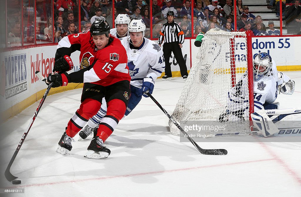 Zack Smith #15 of the Ottawa Senators swings the puck wide of the net as <a gi-track='captionPersonalityLinkClicked' href=/galleries/search?phrase=Tyler+Bozak&family=editorial&specificpeople=6183313 ng-click='$event.stopPropagation()'>Tyler Bozak</a> #42 and James Reimer #34 of the Toronto Maple Leafs look on at Canadian Tire Centre on April 12, 2014 in Ottawa, Ontario, Canada.