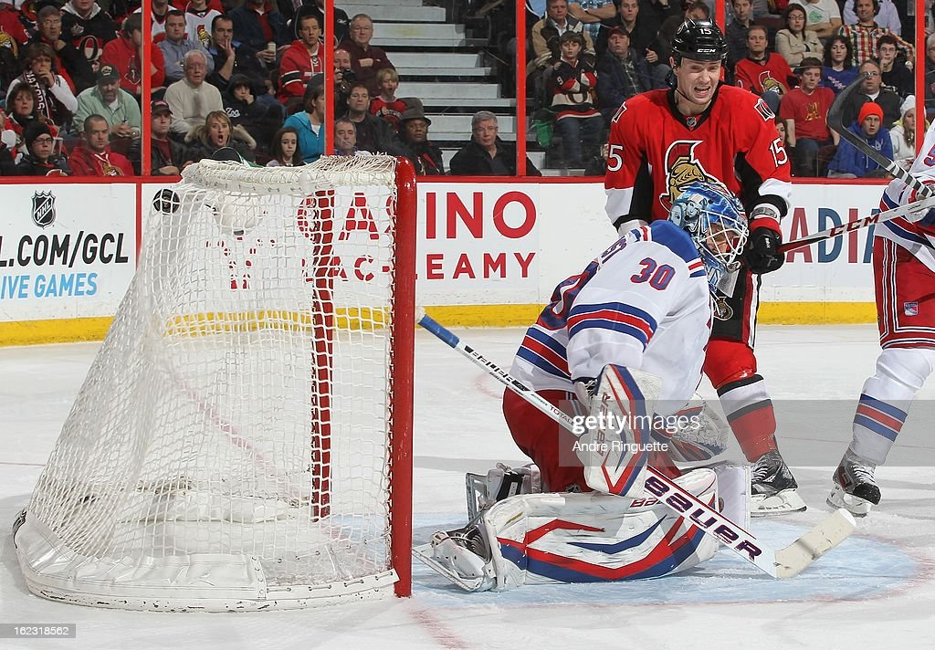 Zack Smith #15 of the Ottawa Senators watches the puck hit the back of the net behind Henrik Lundqvist #30 of the New York Rangers for a third period goal on February 21, 2013 at Scotiabank Place in Ottawa, Ontario, Canada.