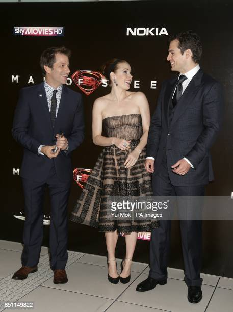 Zack Snyder Amy Adams and Henry Cavill arriving for the European premiere of Man of Steel at the Odeon Leicester Square London