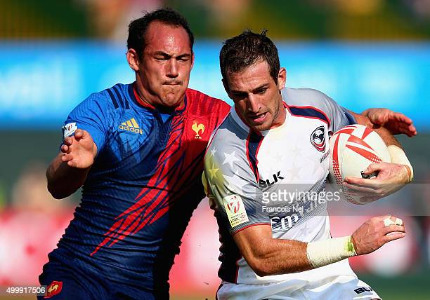 Zack Test of the USA is tackled by Damien Cler of France during the Emirates Dubai Rugby Sevens HSBC World Rugby Sevens Series on December 4 2015 in...