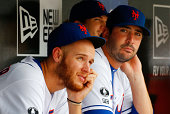 Zack Wheeler and Matt Harvey of the New York Mets look on against the Philadelphia Phillies at Citi Field on August 31 2014 in the Flushing...