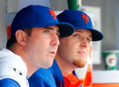 Zack Wheeler and Matt Harvey of the New York Mets look on against the Washington Nationals at Citi Field on April 3 2014 in the Flushing neighborhood...
