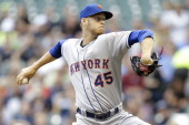 Zack Wheeler of the New York Mets pitches during the first inning against the Milwaukee Brewers at Miller Park on July 25 2014 in Milwaukee Wisconsin