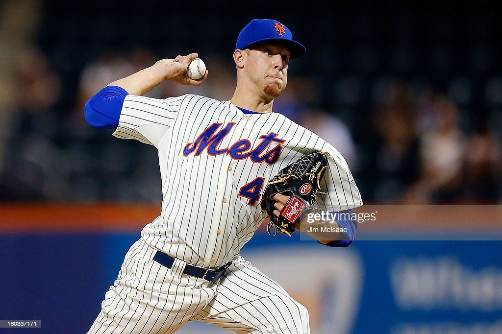 <a gi-track='captionPersonalityLinkClicked' href=/galleries/search?phrase=Zack+Wheeler&family=editorial&specificpeople=7091383 ng-click='$event.stopPropagation()'>Zack Wheeler</a> #45 of the New York Mets pitches in the first inning against the Washington Nationals at Citi Field on September 11, 2013 in the Flushing neighborhood of the Queens borough of New York City.