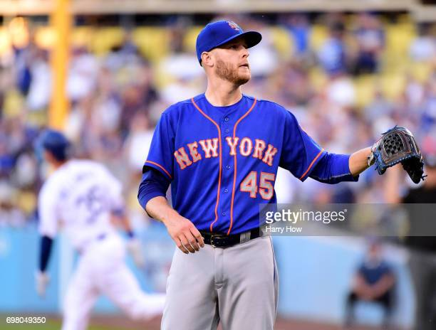 Zack Wheeler of the New York Mets reacts to a three run homerun from Cody Bellinger of the Los Angeles Dodgers to trail 40 during the first inning at...