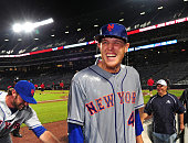 Zack Wheeler of the New York Mets smiles after being doused with a beer shower after game two of a doubleheader against the Atlanta Braves at Turner...