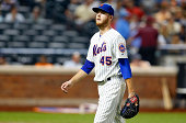 Zack Wheeler of the New York Mets walks back to the dugout after the third inning against the Atlanta Braves at Citi Field on August 27 2014 in the...
