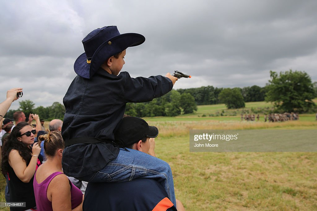 Zackary Howey, 6, from Warren, Michigan, dressed in Union attire, 'fires' on Confederate Civil War re-enactors on the 150th anniversary of the historic Battle of Gettysburg on July 2, 2013 in Gettysburg, Pennsylvania. The battle, which took place July 1-3, 1863, is widely considered the turning point in the American Civil War in favor of the Union. Federal and Confederate armies suffered a combined total of 51,000 casualties over three days, the highest number of any battle in the four-year war.