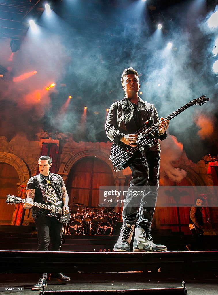 Zacky Vengeance (L) and Synyster Gates of Avenged Sevenfold performs during the Hail to the King Tour at Joe Louis Arena on October 13, 2013 in Detroit, Michigan.