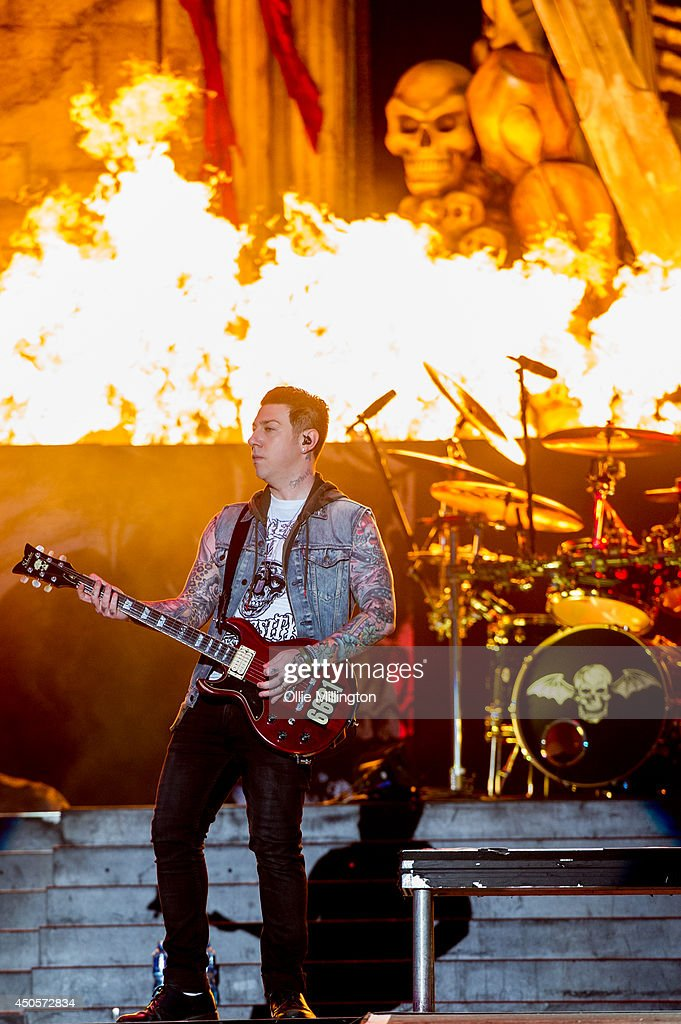Zacky Vengeance of Avenged Sevenfold performs on stage headlining on day 1 at Download Festival at Donnington Park on June 13, 2014 in Donnington, United Kingdom.