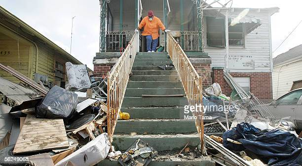 Zadie Smith rests while cleaning her home in the heavily damaged Ninth Ward November 21 2005 in New Orleans Louisiana Smith is attempting clean up...
