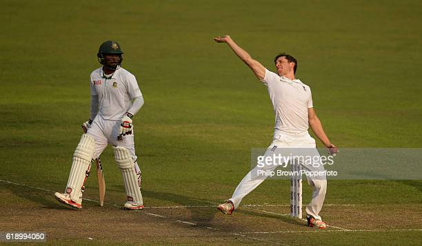 Zafar Ansari bowls watched by Mahmudullah during the second day of the second test match between Bangladesh and England at Shere Bangla National...