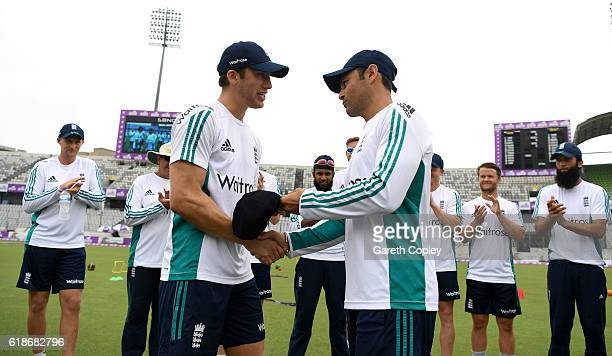 Zafar Ansari of England is presented with his test cap by former England batsman Mark Ramprakash ahead of the first day of the 2nd Test match between...