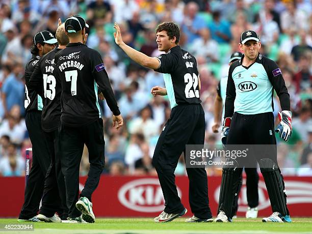 Zafar Ansari of Surrey celebrates with team mates after taking the wicket of Craig Overton of Somerset during the Natwest T20 Blast match between...