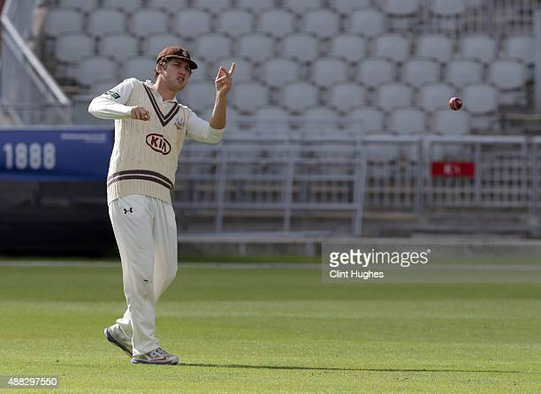 Zafar Ansari of Surrey fields during day two of the LV County Championship Division Two match between Lancashire and Surrey at Emirates Old Trafford...