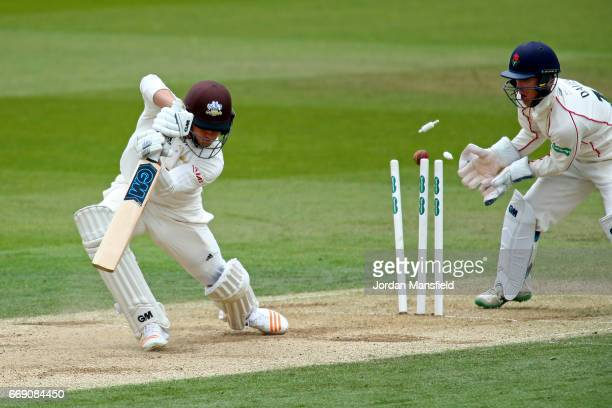 Zafar Ansari of Surrey is bowled out by Simon Kerrigan of Lancashire during day three of the Specsavers County Championship Division One match...
