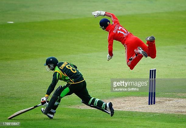 Zafar Gohar of Pakistan avoids a run out in front of a diving Ben Duckett of England during the Triangular Under 19 Series Final between England U19...