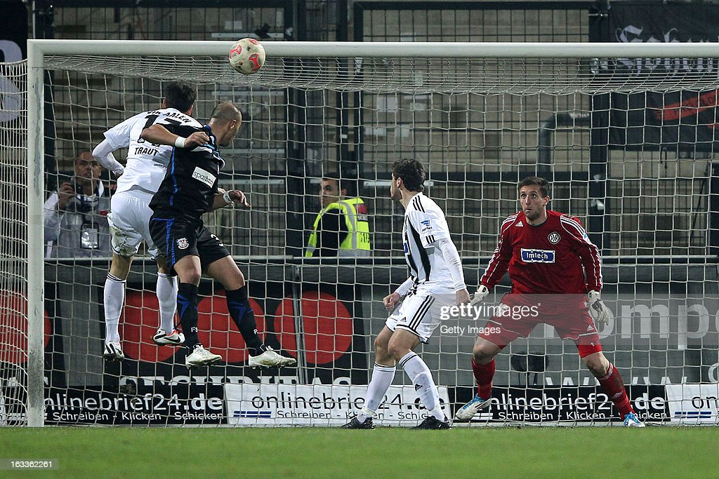 Zafer Yelen of Frankfurt (2L) scores his team's fifth goal against goalkeeper Jasmin Fejzic, Sascha Traut and Tim Kister of Aalen (L-R) during the Second Bundesliga match between FSV Frankfurt and VfR Aalen at Frankfurter Volksbank Stadium on March 8, 2013 in Frankfurt am Main, Germany.