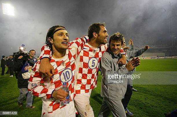 Croatian national soccer team players Niko Kovac Igor Tudor and Anthony Seric celebrate after their team won 10 against Sweden in their 2006 World...