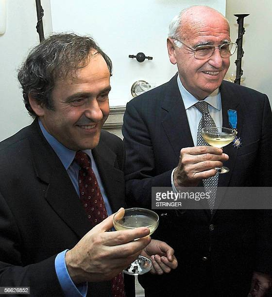 Famous Franch soccer player and French National soccer team official Michael Platini and his Croatian counterpart Vlatko Markovic toast a glass of...