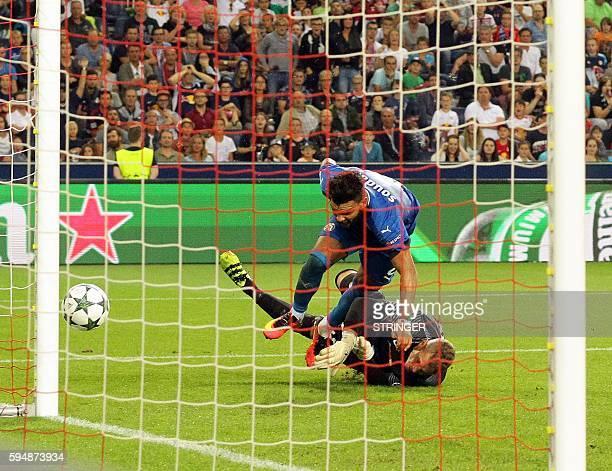 Zagreb's El Arabi Hilal Soudani vies with Salzburg's goalkeeper Alexander Walke during the UEFA Champions League Qualification Playoffs match Red...