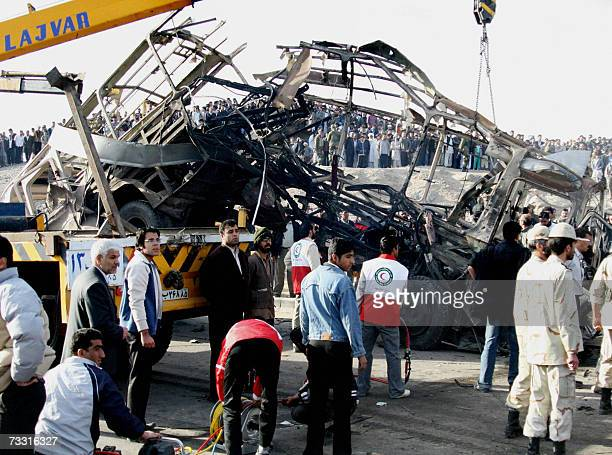 Iranian aid workers and Revolutionary Guards secure the site where a boobytrapped car exploded in front of a bus and killed eleven people in Zahedan...