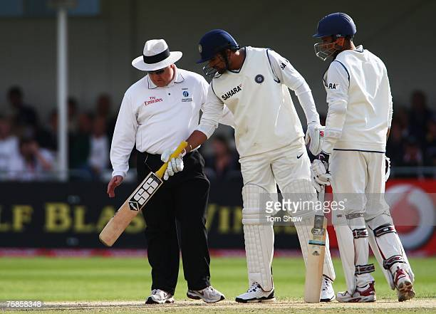 Zaheer Khan and Anil Kumble of India inspect the pitch with umpire Ian Howell during day three of the Second Test match between England and India at...
