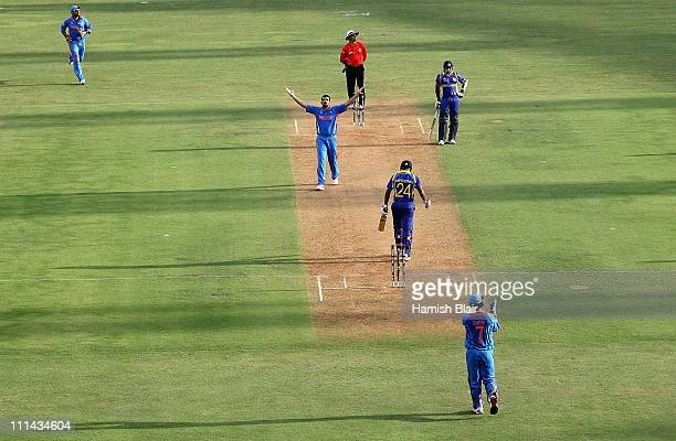 Zaheer Khan of India celebrates after taking the wicket of Chamara Kapugedera of Sri Lanka during the 2011 ICC World Cup Final between India and Sri...