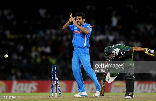 Zaheer Khan of India celebrates as Yasir Arafat of Pakistan gets run out by a direct hit from Yuvraj Singh during the ICC T20 World Cup Super Eight...