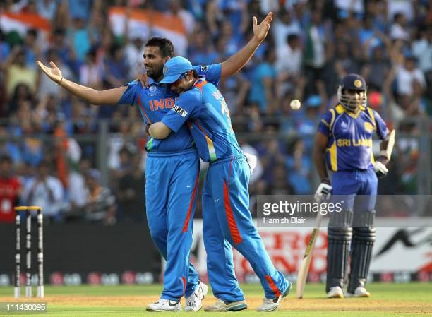 Zaheer Khan of India celebrates with team mate Virat Kohli after taking the wicket of Chamara Kapugedera of Sri Lanka with Mahela Jayawardene of Sri...