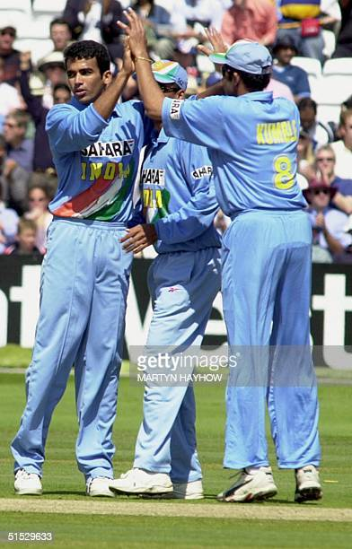 Zaheer Khan of India is congratulated by teammate Anil Kumble after bowling out Nick Knight of England in the Natwest series final at Lords 13 July...