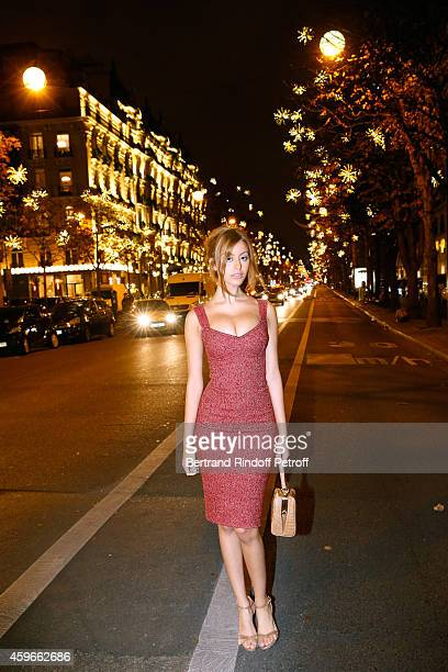 Zahia Dehar poses in Montaigne Avenue after the Launche of Christmas Montaigne Avenue Illuminations during the 19th Edition of 'Les Sapins de Noel...