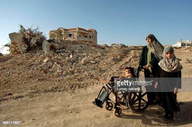 Zahia Karneeb walks with her two children through the village of Maroun al Ras in southern Lebanon August 29 2006 Israeli troops are still in the...