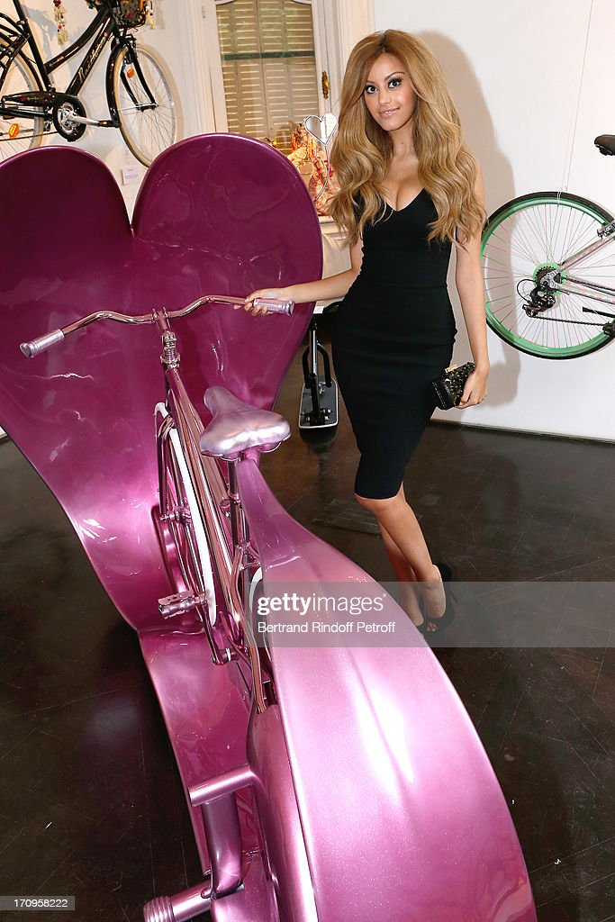 Zahia standing near her bike 'Invitation to travel' at 'Arty Bike' Auction to benefit Association des Tout P'tits at Artcurial on June 20, 2013 in Paris, France.