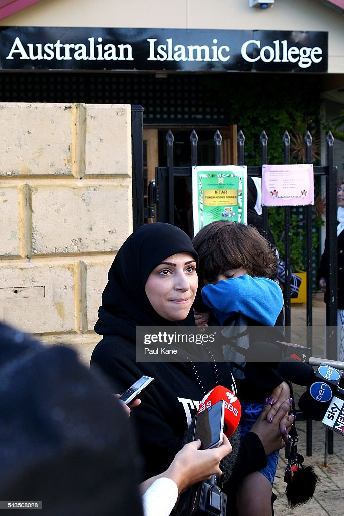 Zahra Alasadi talks with reporters outside the Thornlie Australian Islamic College and Mosque on June 29, 2016 in Perth, Australia. Police are investigating a firebomb attack which occurred last night at the Thornlie Mosque. No one was injured in the attack which took place during evening prayers.