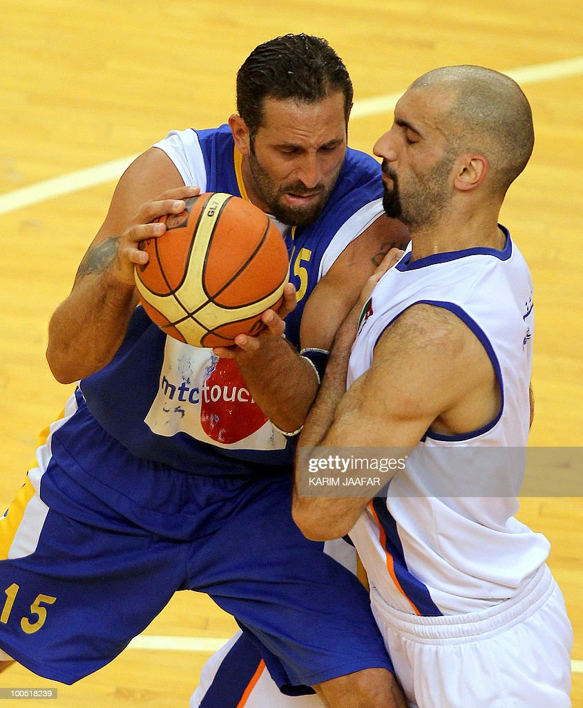 Zaid Abbas of Jordan's ASU club (R) challenges Fadi el-Khatib of Lebanon's Al-Riyadi during their 21st FIBA Asia Champions Cup basketball match at Al-Gharafa Indoor Stadium in Doha on May 25, 2010.