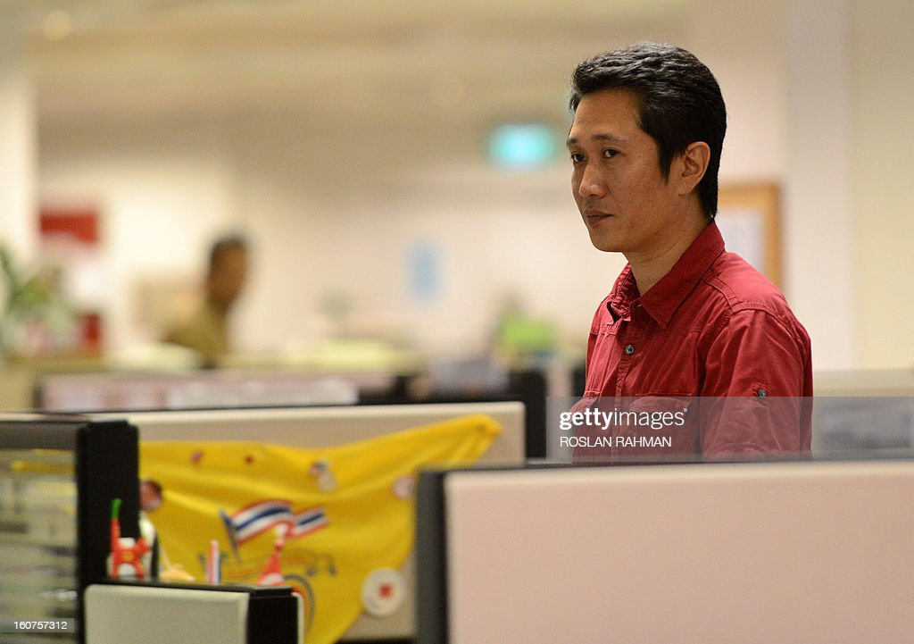 Zaihan Mohamed Yusof, an investigative reporter with Singapore's New Paper stands at his office cubicle on February 5, 2013. Singapore's squeaky-clean image as one of the world's least corrupt nations took a hit after revelations that criminals based in the city-state rigged hundreds of football matches in Europe and elsewhere. Yusof, who is considered a leading authority on match-fixing, admitted he was taken aback by the numbers revealed by Europol.