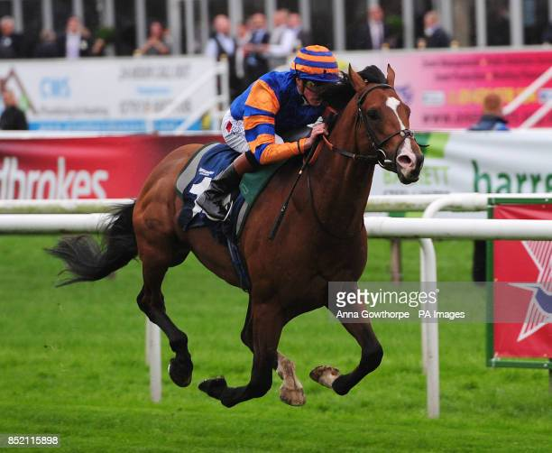 Zain Eagle ridden by James Doyle wins the Frank Whittle Partnership Classified Stakes during the Speedy Services Doncaster Cup Day of the Ladbrokes...