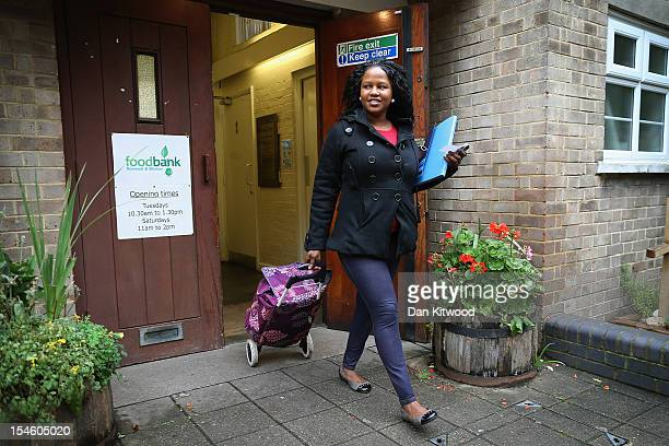 Zainab Kamara from Sierra Leone leaves after collecting a food package at a Food Bank depot at St Paul's Church in Brixton on October 23 2012 in...