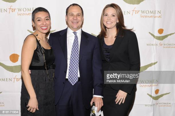 Zainab Salbi Michael Altman and Erica Hill attend WOMEN FOR WOMEN GALA at Chelsea Piers on November 9 2010 in New York City