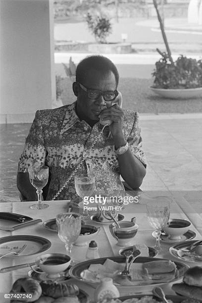 Zaire President Mobutu Sese Seko telephoning while dining in Kolwezi in 1979 ten months after the Kolwezi massacre After the May 1978 massacre at...