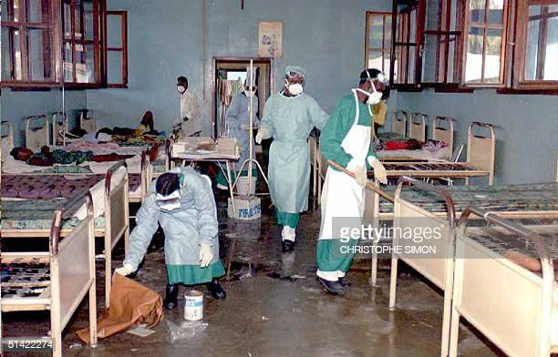Zairean hospital orderlies clean the ward occupied by patients affected by the deadly Ebola virus 14 May at the hospital in Kikwit 320 miles...