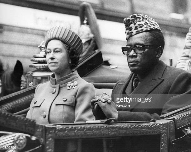Zairean president Mobutu Sese Seko and Queen Elizabeth II en route to Buckingham Palace from Victoria railway station at the start of his State Visit...