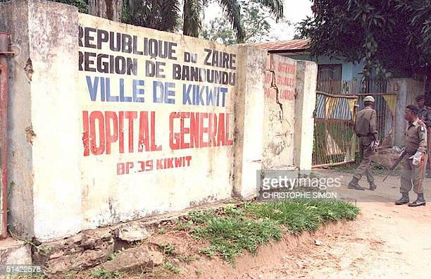 Zairean soldiers stand guard at the entrance of the Kikwit Zaire hospital 13 May where patients are treated for the deadly Ebola virus The World...