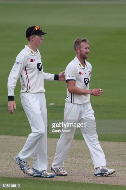 Zak Crawley of Kent pats bowler Adam Ball on the back in congratulations after he bowls Kyle Hope of West Indies during day one of the tour match...