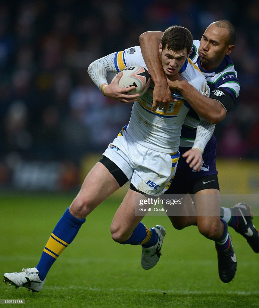 Zak Hardaker of Leeds is tackled by Matty Blythe of Bradford during Rugby League pre-season friendly between Leeds Rhinos and Bradford Bulls at Headingley Stadium on January 20, 2013 in Leeds, England.